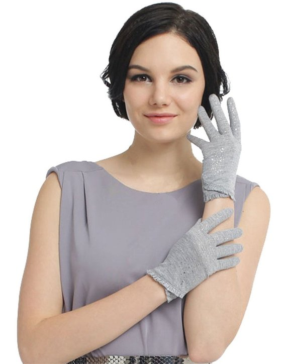 woman showing her hand in gloves