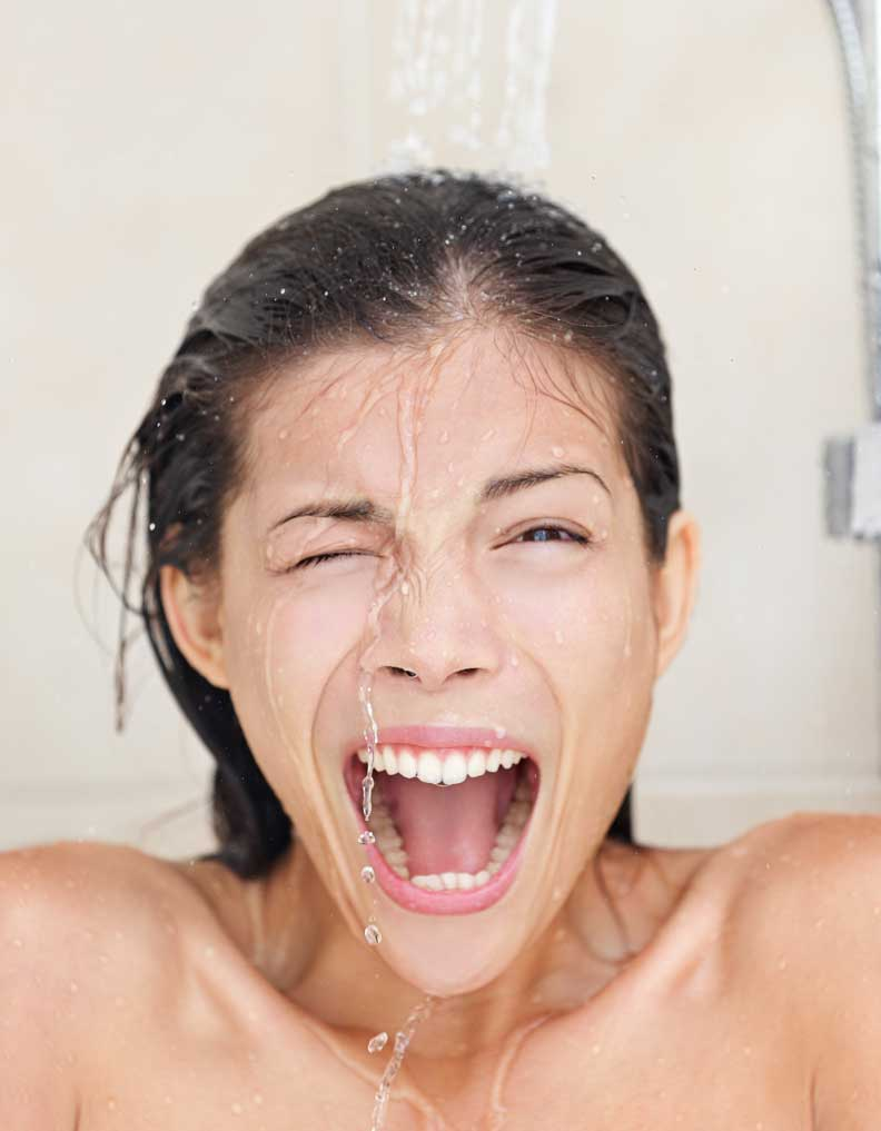 woman in shower screaming from cold