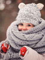 READERSDIGEST Baby covered in scarf and hat smiling