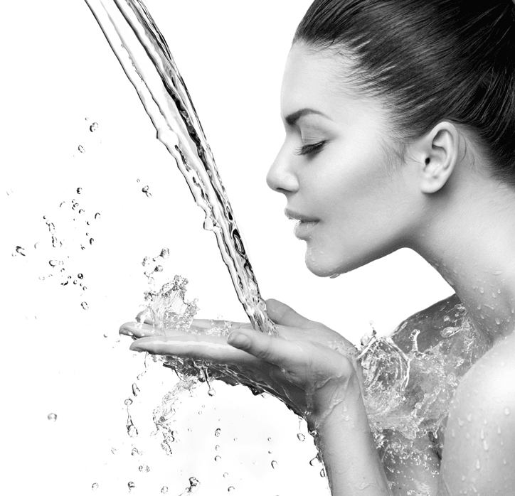 Woman Side profile water streaming on to hands